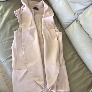 Limited sleeveless blazer
